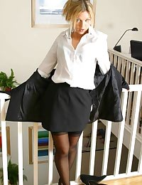 Belle in secretary outfit with black stockings