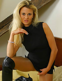 In very short secretary dress with tan pantyhose and boots