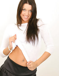 Sultry dark haired Beckie with satin miniskirt and tan pantyhose