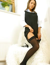 Sexy brunette Sabrina in secretary dress with opaque stockings