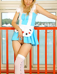 Natasha in Alice in Wonderland outfit with white opaque holdups