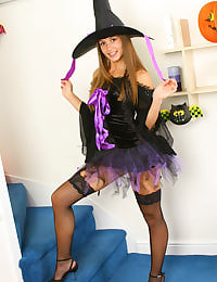 Sadie in fishnet stockings all ready for Halloween
