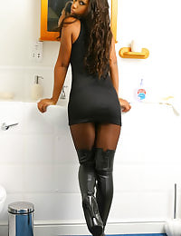 Stunning Teri gets all wet in the shower after she strips out of her tight black minidress and pantyhose.