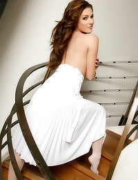 Prestige at OnlyTease with busty brunette Lucy Pinder in stunning white 'Marilyn Monroe' dress and stockings.
