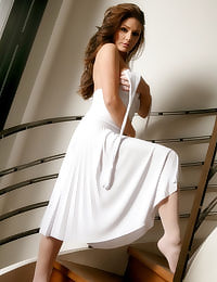 Uk glamour babe Lucy Pinder in stunning white 'Marilyn Monroe' dress and stockings.