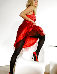 Beautiful lady in red Hayley-Marie in a sexy evening dress with black stockings.