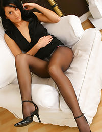 Emily J in black miniskirt and cropped top blouse and pantyhose.