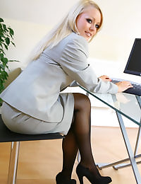 Cute secretary wearing skirt suit
