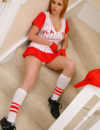 Stunning busty blonde in sexy baseball outfit.