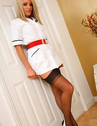 Sexy nurse strips out of her uniform and black stockings.