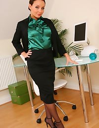 Gorgeous brunette Carla shows off the stunning body beneath her office clothes.