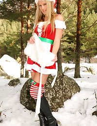 Alexis wearing a santa's outfit with long stockings and boots.