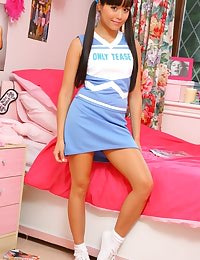 Lily looking amazing in her cheerleaders uniform on her bed.