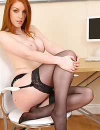 Beautiful secretary in black office suit and silk blouse.