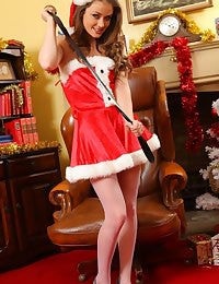 Jess Impiazzi makes for a real treat at christmas in her sexy santa outfit.