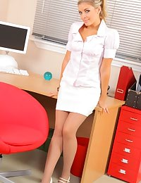 Naughty blonde secretary teases her colleagues as she slowly slips out of her work clothes.
