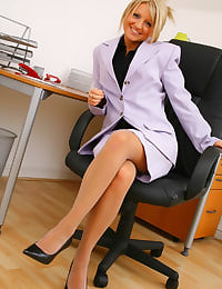 Adorable Liana Lace slowly removes her sexy secretary outfit in her office revealing her grey