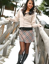 Dark haired beauty in miniskirt