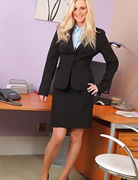 Meklaina looks smart and sexy in her black skirt suit