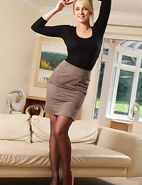 Stacey treats us to flashes of her holdup stockings underneath her miniskirt