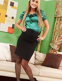 Kinky blonde secretary teases her way out of her tight silk blouse and black pencil skirt.