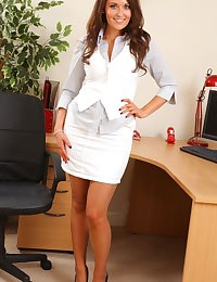Long haired beauty looking great in her secretary outfit and even better out of it.