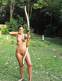 Eve Angel poses naked outdoors