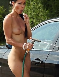 After a Carwash Euro Babe Melissa Cools Her Pussy Off with her shaved pussy
