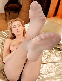 Coxy taking off pantyhose