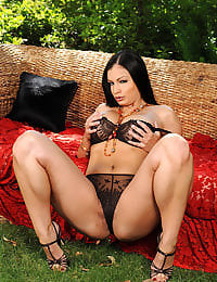 Aria Giovanni posing outdoors
