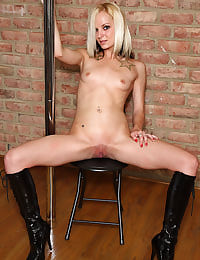 Faye Runaway Works the Stripper Pole with her shaved pussy