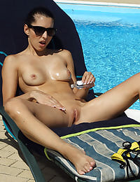 Bikini Babe Playful Anne Soaking Up the Sun with her shaved pussy