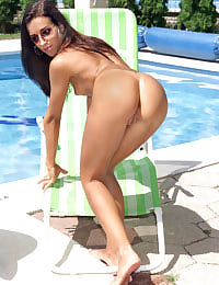 Roxanne Posing by the Pool with her shaved pussy