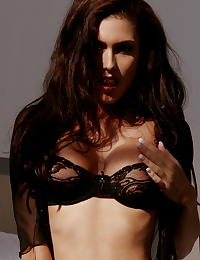 Jessica Jaymes in sticks her hand down her black skirt