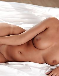 Laetitia in is a hot Euro brunette with a sweet smile