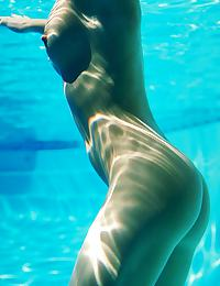 Sophia in loves to feel the cool water on her nude curves