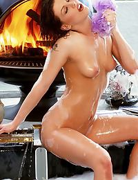 Jezebelle Bond in gets wet near the warm fireplace