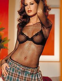 McKenzie Lee in Plaid skirt with black fish net top and bra