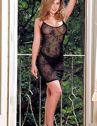 Erica Campbell in lounges around in her black nightie