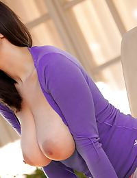 Stacey Rae in takes her large naturals out of her purple shirt