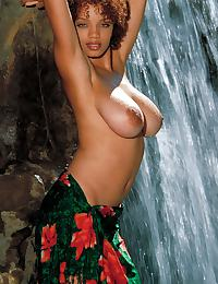 Gia Lashay in cools herself off at a waterfall