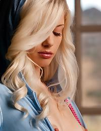 Charlotte Stokely in looking cute and sexy in her baby blue hoodie