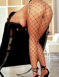 Nika in looks stunning in black fishnets