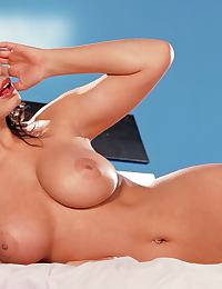 Aria Giovanni in peels out of her pink lace bra and panties