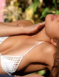 Charmane Star in is a tanned Asian beauty in a white bikini
