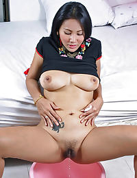 Asian Nancy Hi, toys her hairy pussy and pisses in a bowl