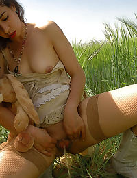 curly brunette toys her pussy with a cucumber wearing crotchless fishnet stockings
