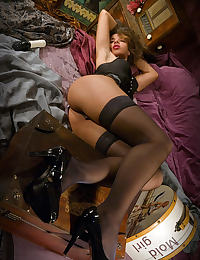 a vintage set with Idoia in black stockings enjoying her dildo on a bed