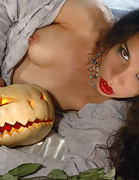 doia in white stockings plays dirty with her halloween pumpkin