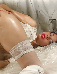 Idoia dressed in white nylons in a cream mess enjoying her dildo